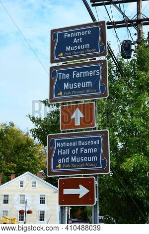COOPERSTOWN, NEW YORK - SEPT 28, 2018: Direction Signs in the historic town of Cooperstown, New York.