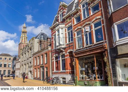 Groningen, Netherlands - March 14, 2020: Street With Historic Houses And Church Tower In Groningen,