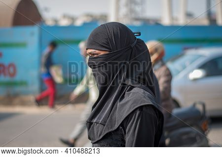 Jaipur, India. 09-05-2018. Portrait Of A Muslim Woman Dress In Black In The Local Market In The Cent