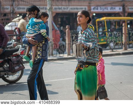 Jaipur, India. 09-05-2018. Mother, Father And Two Children Walking On The Streets Of Jaipur While Bu