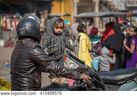 Jaipur, India. 09-05-2018. Small Child With His Father In A Standing On A Motorcycle On The Streets