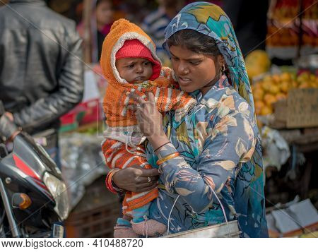 Jaipur, India. 09-05-2018. Rajasthan. Mother With Small Baby Walking On The Streets Of Jaipur In The