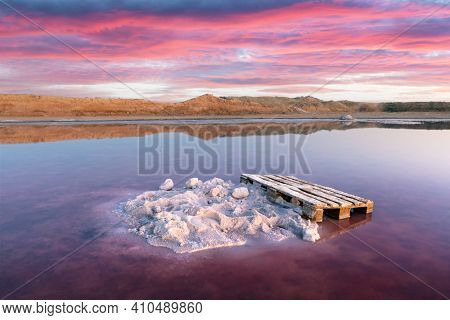 Salt crystals in pink water salt lake in Ukraine, Europe. Landscape photography