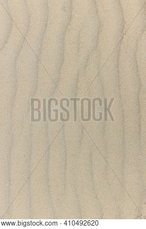 Natural Sand Stone Texture Background. Sand On The Beach As Background. Wavy Sand Background For Sum