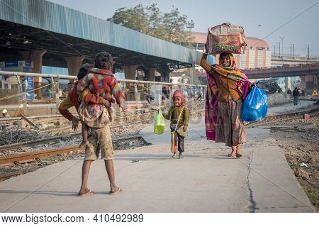 Jaipur, India. 09-05-2018. Family Carrying Their Belongings At The Main Train Station In Jaipur.