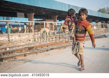 Jaipur, India. 09-05-2018. A Child Is Carrying His Small Sister At The Main Train Station In Jaipur.