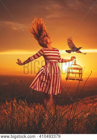 Pretty woman outside during sunset with birds flying around her