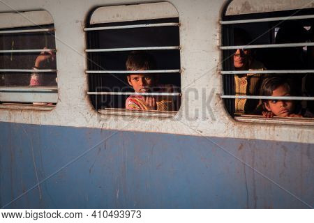 Jaipur, India. 09-05-2018. Portrait Of Traveling Children Waiting The Train To Start At The Main Tra