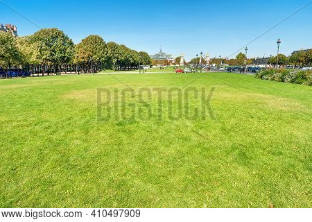 Esplanade With Green Lawn Near Les Invalides Palace In Paris, France
