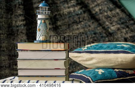 Interior Items - Pillows, Books And A Lighthouse In The Room