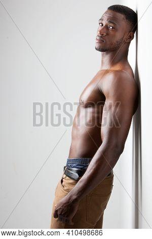 Dark Skinned Male Fitness Model On Light Background