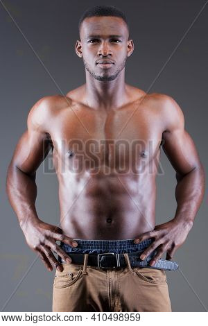 Dark Skinned Male Fitness Model On Grey Background