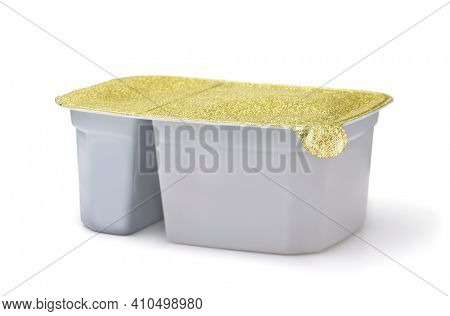 Plastic disposable two compartment food container with foil cover isolated on white