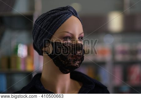 Head Of A Mannequin In A Lacy Black Mask. Fashion Adjusts To The New Norm.