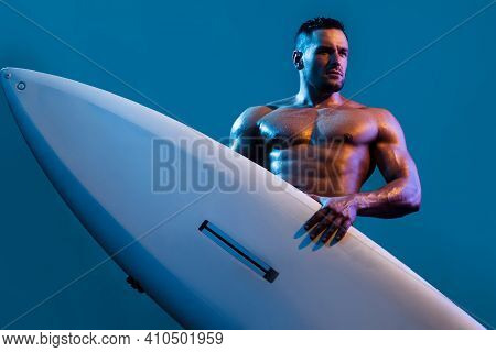 Guy On Beach With Surfboard. Young Surfer Man Holding Serf Board. Summer Vacation Concept. Sexy Musc