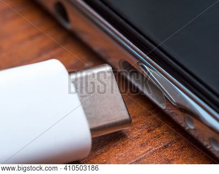 Usb Type-c Cable Next To Smartphone Input.