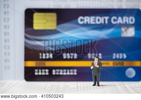 Business Financial And Money Concept. Businessman Miniature Figure People Standing On Bank Passbook
