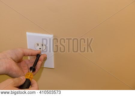 Removing Wall Outlet Cover In Order To Mask The Outlet In Preparation For Painting Wall The House Re