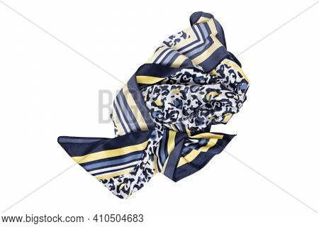 Silk Shawl Isolated. Closeup Of A Beautifully Folded Multicolored Blue Yellow Silk Scarf Or Headscar