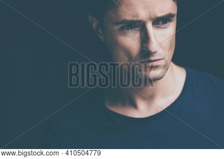 Young man suffering from anxiety, depression due to social seclusion, isolation, COVID induced lockdown