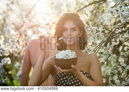 Healthy Food Couple. Dieting Concept. Vegeterian Vegan Woman Man Eating Bloom Of Cherry Tree