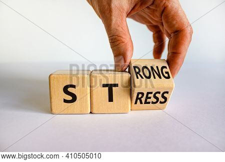 Strong Stress Symbol. Businessman Turns Wooden Cubes With Words 'strong Stress'. Beautiful White Bac