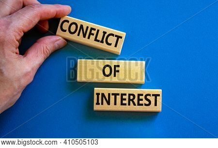 Conflict Of Interest Symbol. Wooden Blocks With Words 'conflict Of Interest'. Beautiful Blue Backgro