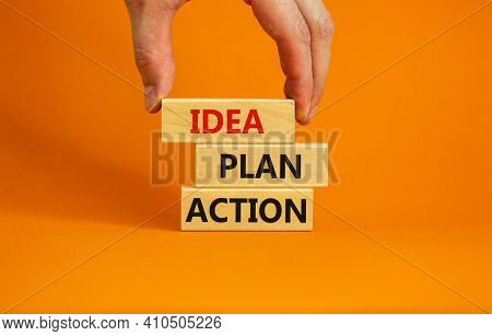 Idea, Plan, Action Symbol. Wooden Blocks Form The Words 'idea, Plan, Action' On Beautiful Orange Bac