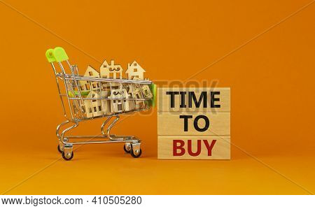 Time To Buy Real Estate Symbol. Wooden Blocks, Words 'time To Buy' On Beautiful Orange Background. S