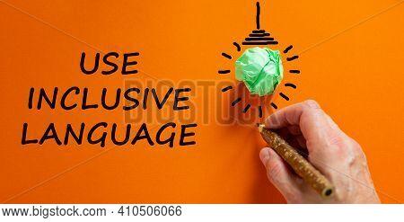 Use Inclusive Language Symbol. Businessman Writing Words 'use Inclusive Language', Isolated On Orang