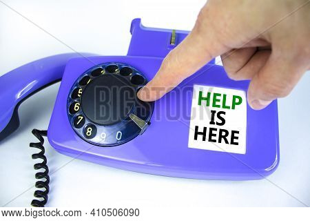 Help Is Here Symbol. Old Blue Rotary Dial Telephone. Words 'help Is Here'. Beautiful White Backgroun