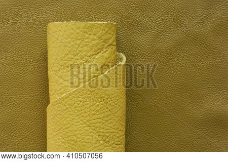 Yellow Genuine Leather Roll.real Leather Set. Leather In Rolls On A Dark Beige Leather Surface.hobby