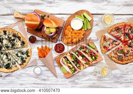 Healthy Plant Based Fast Food Table Scene. Top View On A White Wood Background. Cauliflower Crust Pi