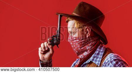 Portrait Of Cowboy In Hat. Portrait Of Man Wearing Cowboy Hat, Gun. Portrait Of A Cowboy. West, Guns