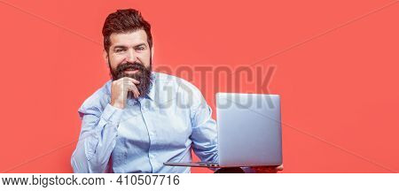 Holding Laptop Computer. Smiling Handsome Bearded Man Worker Laptop. Happy Young Man Sitting On The
