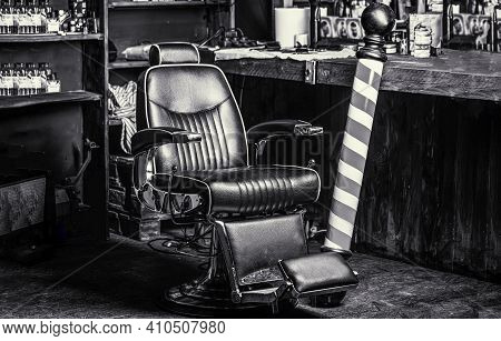 Logo Of The Barbershop, Symbol. Stylish Vintage Barber Chair. Hairstylist In Barbershop Interior. Ba