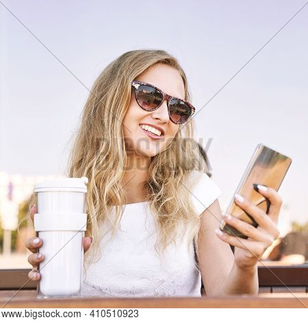 Pretty Young Woman Texting By Phone. Happy Female Person In Outdoors Cafe. Summer Business Portrait.