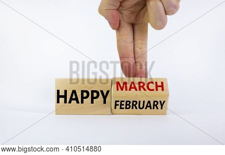 Symbol For The Change From February To March. Businessman Turns Wooden Cubes And Changes Words 'happ