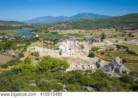Ruins of Patara the ancient Lycian city. Archaeological site in Turkey, Amphitheatre and Assembly Hall of Lycia public with surrounding landscape