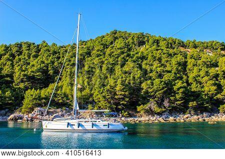 Hvar, Croatia - October 2, 2011: View Of A Sailboat Near Cove Close To Hvar Island On A Sunny Day