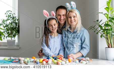 Happy Family With Easter Eggs. Happy Family Preparing For Easter