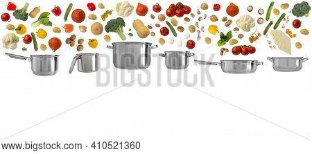 Lots Of Colorful Bright Vegetables, Eggs, Lasagna Falling Into Set Of 6 Pots, Pans, Saucepans And Di
