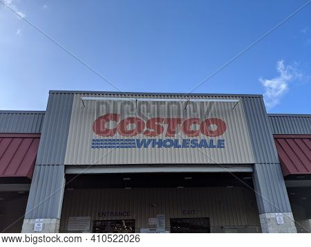 Honolulu - February 21, 2020:  Costco Wholesale Store Exterior Sign. Costco Wholesale Corporation Is