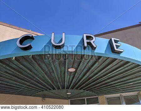 Honolulu - February 25, 2020: Cure Oahu Sign On Building. Cure Oahu Is A Cannabis Dispensary Located