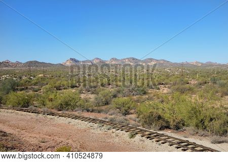 APACHE JUNCTION, ARIZONA - DECEMBER 8, 2016: Train tracks in the desert at Goldffield Ghost Town, Apache Junction, Arizona.