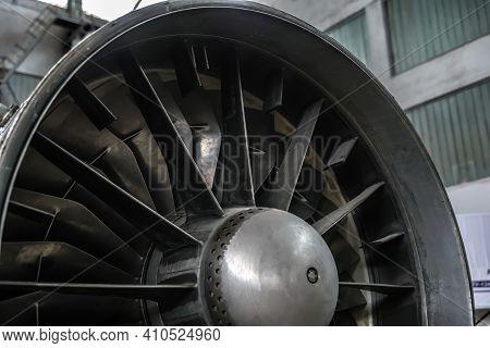 The Turbine Of A Jet Aircraft Undergoing Maintenance In A Hangar. Selective Focus.