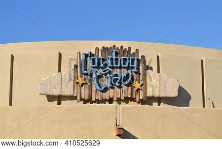 SCOTTSDALE, ARIZONA - JUNE 27, 2011: Cowboy Ciao Restaurant sign. Opened in 1997 It has features a Modern American menu with Southwest accents and Global influences.