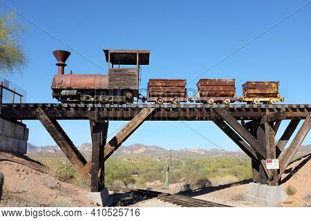 APACHE JUNCTION, ARIZONA - DECEMBER 8, 2016: Ore Cars on trestle at the Goldfield Ghost Town, in Apache Junction, Arizona, off of Route 88.