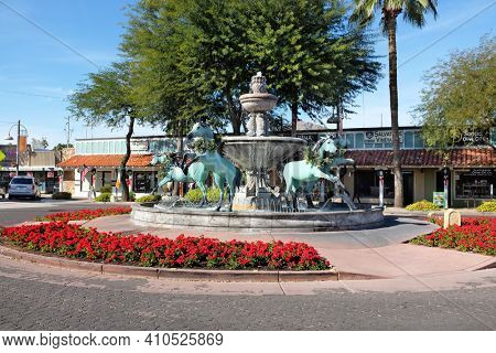 SCOTTSDALE, ARIZONA - DECEMBER 9, 2016: Horse Fountain in the Old Town area of Scottsdale, Arizona. Donated in 1989 by artist and gallery owner Bob Parks. The fountain depicts 5 rearing horses.