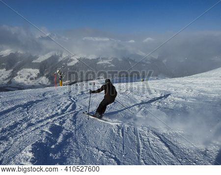 Young Men Skiing In The Swiss Mountains At Davos Klosters Switzerland At Ski Slope On Jakobshorn